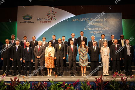 Stock Picture of Finance Ministers Pose For a Group Photo at the 21-member Asia-pacific Economic Cooperation (apec) Summit in Singapore 12 November 2009 Front Row L-r Russia's Finance Minister Alexy Kudrin New Zealand's Finance Minister Bill English Philippines Finance Secretary Margarito Tevez the International Monetary Fund's Dominique Strauss-kahn Indonesia's Finance Minister Sri Mulyani Indrawati Foreign Ministerial Meeting Chairman and Singapore Finance Minister Tharman Shanmugaratnam Us Secretary of the Treasury Timothy Geithner Chile's Undersecretary of Finance Maria Olivia Recart Canada's Finance Minister James Flaherty Peru Representative Claudia Cooper Hong Kong's Finance Secretary John Tsang and South Korea's Deputy Finance Minister Shin Je Yoon Back Row L-r Mexico's Ministry of Finance Head of International Affairs Unit Ricardo Ochoa China's Assistant Minister of Finance Zhu Guangyao Brunei's Minister of Finance Pehin Dato Abd Rahman Asian Development Bank President Haruhiko Kuroda Australia's Treasurer Wayne Swan Vietnam's Vice Finance Minister Tran Xuan Ha World Bank President Robert Zoellick Thailand's Finance Minister Korn Chatikavanij Malaysia's Minister of Finance Ahmad Husni Japan's Parliamentary Secretary For Finance Shinichiro Furumoto Chinese Taipei's Minister of Finance Such-der Lee and Papua New Guinea's Minister For Treasury and Finance Benjamin Poponawa