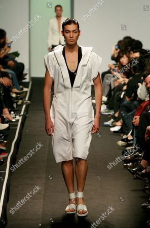 A Model Displays a Creation Designed by Song Zio During the Seoul Fashion Week Spring / Summer 2010 Collection in Seoul South Korea 17 October 2009