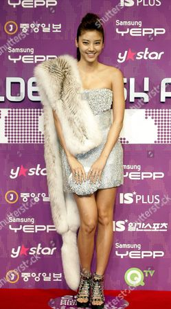 South Korean Singer Model and Actress Son Dam Bi Poses As She Arrives For the 24th Golden Disk Awards at the Olympic Hall at Seoul's Olympic Park South Korea 10 December 2009