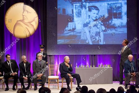 California Hall of Fame Inductees Stuart Milk (l-r) For His Uncle Harvey Milk Technology Innovator Andrew S Grove Filmmaker George Lucas Body-building Pioneer Joe Weider and Air Force Test Pilot General Chuck Yeager Listen to George Lucas's Introduction As Governor of California Arnold Schwarzenegger (r-rear) Looks at a Photograph of a Young George Lucas During the Induction Ceremony For the California Museum's 'California Hall of Fame' in Sacramento California Usa 01 December 2009 Thirteen Californians Have Been Inducted to the Hall of Fame Including Technology Innovator Andrew S Grove Filmmaker George Lucas Entertainer Carol Burnett and Us Air Force Gen Chuck Yeager