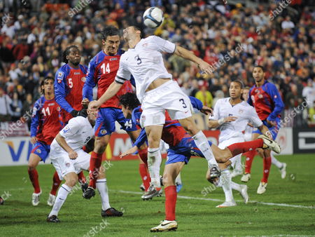 Usa's Carlos Bocanegra (c) and Costa Rica's Randall Azofeifa Collide On a Header During Their World Cup Qualifying Match at Rfk Stadium in Washington Dc Usa 14 October 2009 the Game Ended in a 2-2 Tie the Us Tied the Score in the Final Seconds of the Game