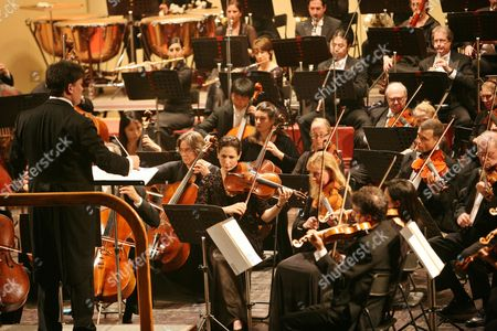 Us Conductor Alan Gilbert (l) Performs During a New York Philharmonic Concert at the Opera House in Hanoi Vietnam 17 October 2009 the New York Philharmonic is in the Vietnamese Capital For the First Time As Part of Its Asian Tour