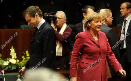 German Chancellor Angela Merkel (r) and Hungarian Prime Minister Gordon Bajnai (l) Smile As They Walk Before the Second Day Session of the Eu Summit in Brussels Belgium 26 March 2010 Belgium Brussels