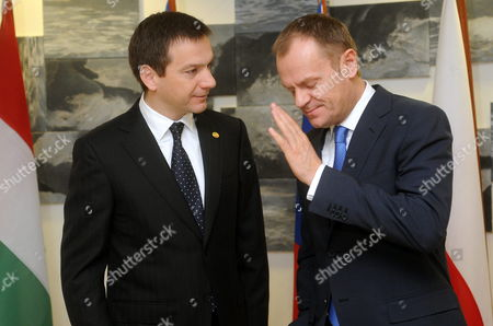 Polish Prime Minister Donald Tusk (r) Gestures As He is Greeted by His Hungarian Counterpart Gordon Bajnai Before a Meeting of the Premiers of the Visegrad Group Held at Hungary's Permanent Representation on the Sideline of the Eu Summit in Brussels Belgium 25 March 2010 Belgium Brussels