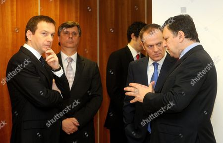 President of the European Commission Jose Manuel Barroso (r) Talks to Polish Prime Minister Donald Tusk (2-r) As Prime Ministers Jan Fischer (2-l) of the Czech Republic and Gordon Bajnai (l) Wait For Slovakian Prime Minister Robert Fico Before a Meeting of the Premiers of the Visegrad Group Held at Hungary's Permanent Representation on the Sideline of the Eu Summit in Brussels Belgium 25 March 2010 Belgium Brussels