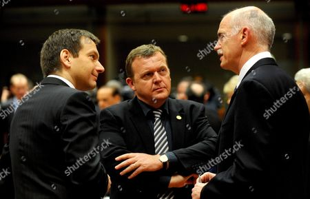 (l-r) Hungarian Prime Minister Gordon Bajnai Danish Prime Minister Lars Lokke Rasmussen and Greek Prime Minister George Papandreou (l-r) Change Some Words Prior to the Start of the Eu Summit in Brussels Belgium 25 March 2010 Belgium Brussels