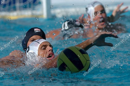 Peter Varellas of the U S (black Cap) and Tamas Kasas of Hungary Go For the Ball During the Hungary Vs United States Friendly Water Polo Match in the Hajos Alfred Swimming Pool in Budapest Saturday June 10 2006 Hungary Budapest