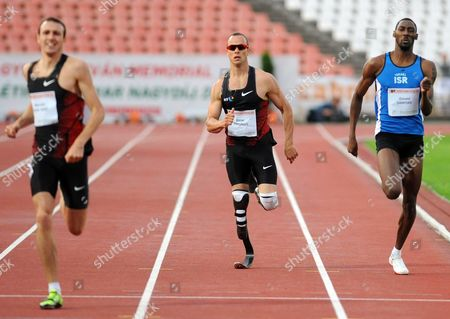 Oscar Pistorius (c) of South Africa Marcell Deak Nagy (l) of Hungary and Donald Sanford (r) of Israel Compete in the Men's 400m Race During the Istvan Gyulai Memorial Hungarian Athletics Grand Prix 2011 in Budapest Hungary 30 July 2011 Hungary Budapest