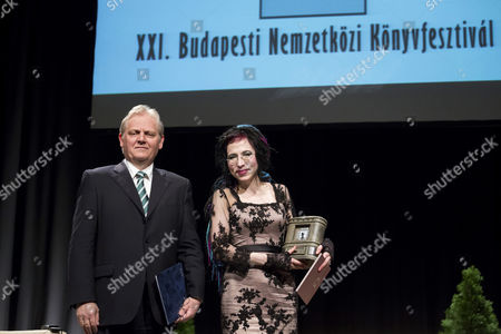 Honorary Guest Finnish Author Sofi Oksanen (r) Smiles Onstage After Being Awarded the Budapest Grand Prize by Budapest Mayor Istvan Tarlos (l) at the 21st Budapest International Book Festival in Budapest Hungary 24 April 2014 the Events Runs From 24 to 27 April Hungary Budapest