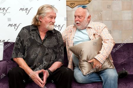 Stock Image of Hungarian-born Us Screenwriter Joe Eszterhas (l) and Hungarian-born Us Film Producer Andrew G Vajna (r) the Government Commissioner in Charge of the Hungarian Film Industry Have a Chat During a Press Conference Prior Their Screenwriting Workshop at the Four Seasons Hotel in Budapest Hungary 06 October 2012 Hungary Budapest