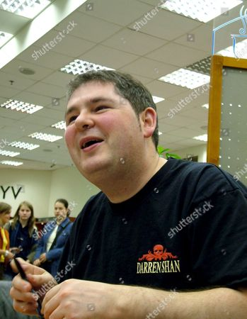 Irish Writer Darren Shan Signs His Latest Book Allies of the Night in Budapest 23 April 2005 Author of the Successful Vampire Books is One of the Foreign Guests of the 12th International Book Fair in Budapest Shans Horror Stories Had Been Translated Into 18 Languages So Far Hungary Budapest