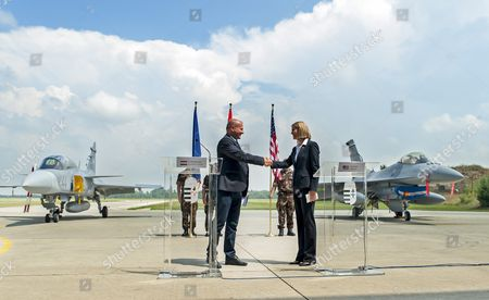 Hungarian Minister of Defence Istvan Simicsko (l) and American Ambassador to Hungary Colleen Bell Shake Hands After Their Joint Press Conference During the Press Day of the Panther Strike 2016 International Military Training at Papa Air Base Near Papa 165 Kms West of Budapest Hungary 27 July 2016 Hungary Papa