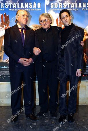 Nobel Prize Winner Hungarian Writer Imre Kertesz Poses with Hungarian Director Lajos Koltai and Child Actor Marcell Nagy (l-r) at the World Premier of the Film 'Fateless' in Budapest Hungary Tuesday Night 08 February 2005 Marcell Nagy is the Star of the Film Based on Kertesz's Most Famous Novel 'Fateless' That is Screened to Ceremonially Close the 36th Hungarian Film Festival Inscription in Background is the Title of the Film in Hungarian Hungary Budapest