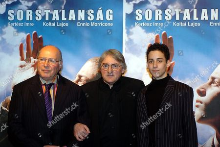 Nobel Prize Winner Hungarian Writer Imre Kertesz Left Poses with Hungarian Director Lajos Koltai Center and Child Actor Marcell Nagy at the World Premier of the Film 'Fateless' in Budapest Hungary Tuesday Night Feb 8 2005 Marcell Nagy is the Star of the Film Based on Kertesz's Most Famous Novel 'Fateless' That is Screened to Ceremonially Close the 36th Hungarian Film Festival Inscription in Background is the Title of the Film in Hungarian Hungary Budapest