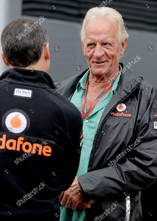 John Button (r) Father of British Formula One Driver Jenson Button of Mclaren Mercedes Talks with a Mechanic in the Paddock on the Hungaroring Circuit in Mogyorod North-east of Budapest Hungary 28 July 2011 the Hungary Formula One Grand Prix Will Take Place in Mogyorod Near Budapest on 31 July 2011 Hungary Mogyorod