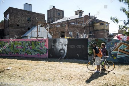 Two Person Look at a Graffiti Depicting a Portrait of Late Italian Actor Carlo Pedersoli Better Known by His Screen Name Bud Spencer in a Street in Budapest Hungary 29 June 2016 Bud Spencer Died in Rome on 27 June at the Age of 86 Hungary Budapest