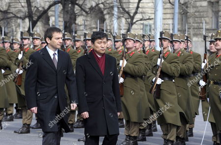 Hungarian Prime Minister Gordon Bajnai (l) and Visiting Mongolian Prime Minister Sukhbaataryn Batbold Inspect the Honour Guards During the Welcoming Ceremony in Front of the Parliament Building in Budapest Hungary 10 March 2010 Hungary Budapest