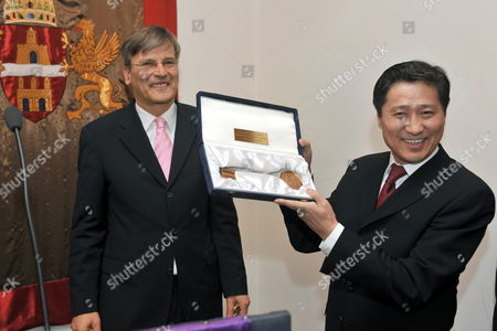 Mongolian Prime Minister Sukhbaataryn Batbold (r) Shows the Symbolic Key of Budapest He Received From Mayor of the Hungarian Capital Gabor Demszky (l) During Their Meeting in the Town Hall in Budapest Hungary 10 March 2010 Batbold is Staying on a Three-day Visit in Hungary Hungary Budapest
