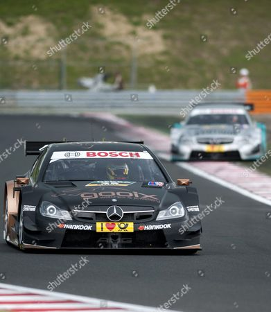 Pascal Wehrlein of Germany Drives His Mercedes Ahead of Spanish Teammate Daniel Juncadella During the Hungarian Round of the German Touring Car Masters Dtm on the Hungaroring Circuit in Mogyorod 23 Kms North-east of Budapest Hungary 01 June 2014 Hungary out Hungary Mogyorod