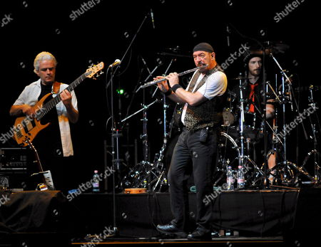 Stock Photo of British Rock Musician Ian Anderson Flutist and Singer of Jethro Tull (c) Performs in Concert Accompanied by David Goodier on Bass (l) and Doane Perry on Drums (r) at Fonix Hall of Debrecen 222 Kms East of Budapest Hungary 03 November 2008 Hungary Debrecen