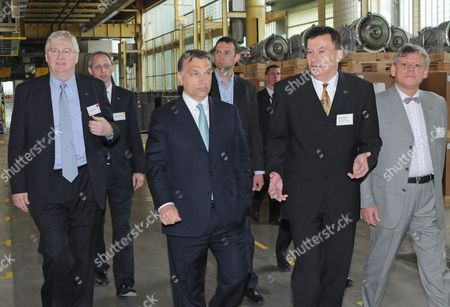 Hungarian Prime Minister Viktor Orban (2-l) and Ceo of Opel and Vauxhall and General Motors Europe President Nick Reilly (l) Walk with Factory Manager Tamas Solt (2nd R) in an Old Assembly Hall After They Laid the Foundation Stone of a New Car Engine Factory of Opel in Szentgotthard 245 Kms West of Budapest Hungary 12 April 2011 with a 20 6 Million Euro Subsidy Granted by the Hungarian State Opel the German Affiliate of Us Carmaker General Motors Invests 500 Million Euro to Enlarge Its Engine Factory in Szentgotthard and Create 800 New Jobs by 2012 Hungary Szentgotthard