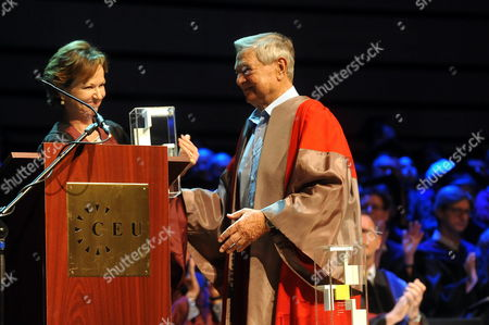 Hungarian Born American Journalist Kati Marton (l) Widow of Late Us Diplomat Richard Holbrooke Receives the Open Society Prize of the Central European University on Behalf of Her Husband From Hungarian Born Us Billionaire Philanthropist and Honorary Chairman of Central European University George Soros (r) During the Graduation Ceremony of the Central European University in Budapest Hungary 16 June 2011 Hungary Budapest