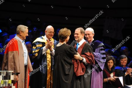 Former Nato General Secretary Javier Solana (2-r) of Spain and Hungarian Born American Journalist Kati Marton (l) Widow of Late Us Diplomat Richard Holbrooke (3-l) Embrace As Hungarian Born Us Billionaire Philanthropist and Honorary Chairman of Central European University George Soros (l) Looks on During the Graduation Ceremony of the Central European University in Budapest Hungary 16 June 2011 Solana was Awarded with the Open Society Prize of the Central European University While Marton Received the Prize on Behalf of Her Late Husband During the Ceremony Hungary Budapest