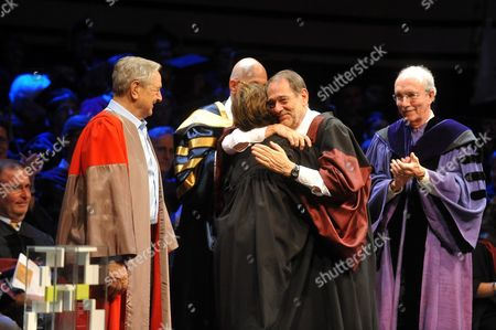 Former Nato General Secretary Javier Solana (2-r) of Spain and Hungarian Born American Journalist Kati Marton (2-l) Widow of Late Us Diplomat Richard Holbrooke Embrace As Hungarian Born Us Billionaire Philanthropist and Honorary Chairman of Central European University George Soros (l) Looks on During the Graduation Ceremony of the Central European University in Budapest Hungary 16 June 2011 Solana was Awarded with the Open Society Prize of the Central European University While Marton Received the Prize on Behalf of Her Late Husband During the Ceremony Hungary Budapest