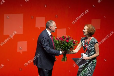 President of the Party of European Socialists (pes) Sergei Stanishev of Bulgaria Receives a Bouquet of Flowers From Pes Vice President Baroness Janet Royall After He was Reelected at the 10th Congress of Pes in the Budapest Convention Centre in Budapest Hungary 12 June 2015 Hungary Budapest