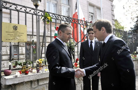 Hungary's Prime Minister Gordon Bajnai (r) Shakes Hands with Polish Embassy Counsel Andrzej R Kalinowski (l) As the Hungarian Premier Pays Condolescences on Polish President's Death Outside Poland's Embassy in Budapest Hungary 11 April 2010 the Previous Day Poland's President Lech Kaczynski His Wife and 94 Others Died in a Plane Crash Near Smolensk Russia As They Were on Their Way to Commemorate the 70th Anniversary of the 1940 Katyn Massacre when Some 22 000 Polish Officers Uniformed Servicemen and Intellectuals Were Executed by the Soviet Nkvd in the Katyn Forest Hungary Budapest