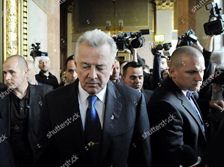Hungarian President Pal Schmitt is on His Way to the Presidential Office After He Announced His Resignation During the Plenary Session of the Parliament in Budapest Hungary 02 April 2012 Hungarian President Pal Schmitt Announced His Resignation on 02 April After He was Found to Have Plagiarized His Doctoral Thesis Pal Schmitt on 02 April Said He Felt 'Obliged' to Relinquish His Mandate As President of Hungary 'The Head of State Embodies the Unity of the Nation Due to the Ongoing Situation i Feel Obliged to Give Back the Mandate of the Presidency ' the Centre-right Politician Told Parliament Hungary Budapest