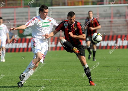 Marcell Fodor (r) of Budapest Honved is Challenged For the Ball by Zoltan Nagy of Debrecen Vsc During Their Hungarian Soccer League Championship Match in Bozsik Jozsef Stadium of Honved in Budapest Hungary 09 May 2009 Debrecen Won 1-0 Hungary Budapest