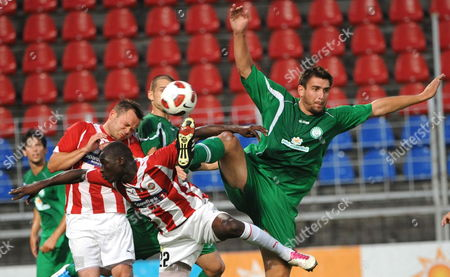 Ciss Saliou (c) of Norway's Tromso and Daniel Bode (r) of Hungary's Paks in Action During Their Uefa Europa League Second Qualifying Round 1st Leg Soccer Match in Szekesfehervar Hungary 14 July 2011 Hungary Szekesfehervar
