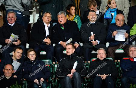 A Picture Made Available on 17 October 2012 Shows (2nd Row L-r) Former Hungarian President Pal Schmitt Hungarian Prime Minister Viktor Orban President of the Hungarian Soccer Federation Mlsz Sandor Csanyi Speaker of the Hungarian Parliament Laszlo Kover Speaker of the Turkish Parliament Cemil Cicek and Former Hungarian Prime Minister Gordon Bajnai (1st Row L) Sit on the Stands Before the Hungary Vs Turkey Soccer World Cup 2014 Group D 4th Round Qualifying Match in Puskas Ferenc Stadium in Budapest Hungary 16 October 2012 Hungary Budapest