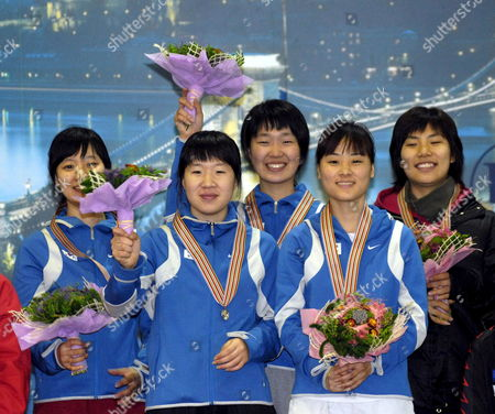 Members of the South Korean Team (l-r) Ji-soo Jeon Eun-ju Jung Chun-sa Byun Min-jung Kim Sun-yu Jin Celebrate on the Podium After Winning the Women's Final of the World Short Track Speed Skating Team Championships in Budapest Hungary Sunday 18 March 2007 Hungary Budapest