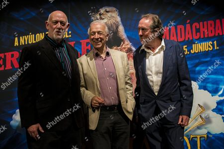 Stock Image of British Comedian Actor Author Member of the English Surreal Comedy Group Monty Python Eric Idle (r) Co-writer John Du Prez (l) and Hungarian Director of the Madach Theatre Tamas Szirtes Pose For a Photo After the Spamalot Musical in Budapest Hungary Late 01 June 2015 Hungary Budapest