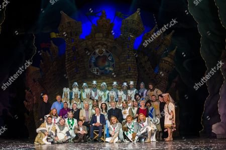 Stock Photo of British Comedian Actor Author Member of the English Surreal Comedy Group Monty Python Eric Idle (c) Co-writer John Du Prez (2nd Row 8-r) and Members of the Madach Theatre Pose For a Family Picture After the Spamalot Musical in Budapest Hungary Late 01 June 2015 Hungary Budapest