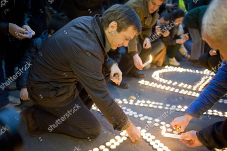 Stock Image of Leader of the Electoral Alliance E-pm Former Hungarian Prime Minister Gordon Bajnai Lights a Candle During a Demonstration in Front of Russian Embassy in Budapest Hungary 02 March 2014 Participants Demanded the Withdrawal of Russian Troops From Ukraine and the Protection of the Rights of Minorities Living in Ukraine Hungary Budapest
