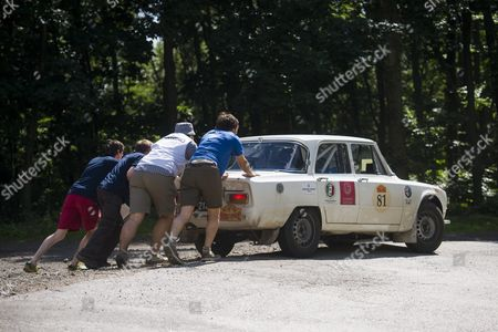 The Broken Down Alfa Romeo Giulia Superberlina Vintage Model of Italian Contestants Francesco Guasti and Alessandro Guasti is Pushed by Helpers During the 380-kilometer-long Route From Kosice Slovakia to Budapest Hungary of the 6th Peking to Paris Motor Challenge 2016 Vintage Car Race Near Galyteto 105 Kilometers Northeast of Budapest Hungary 09 July 2016 a Total of 107 Classic Cars in Two Categories Challenge the 14 000 Kilometres Long Route That Started From the Great Wall Outside Beijing on 12 June to Finish in Place Vendome of the French Capital Paris on 17 July 2016 Hungary Galyateto