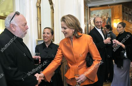 Stock Picture of Us Soprano Renee Fleming (c) Shakes Hands with Hungarian Born Us Film Producer and Hungarian Government Commissioner Andy Vajna (l) As Us Ambassador to Hungary Eleni Tsakopoulos Kounalakis (2-l) Head of the Ballet Company of the Hungarian State Opera House Eldar Aliyev (2nd R) and Ballet Dancer Alesya Popova (r) Look on During a Reception Given by the Ambassador to Honour Fleming at the Ambassador's Residence in Budapest Hungary 09 May 2011 Fleming Will Give a Concert in the Hungarian State Opera on 11 May Hungary Budapest