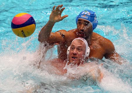 Adam Steinmetz (front) of Hungary in Action Against Amaurys Perez (back) of Italy During Their Men's Water Polo European Championships Group a Match in the Pieter Van Den Hoogenband Swimming Pool in Eindhoven Netherlands 16 January 2012 Netherlands Eindhoven