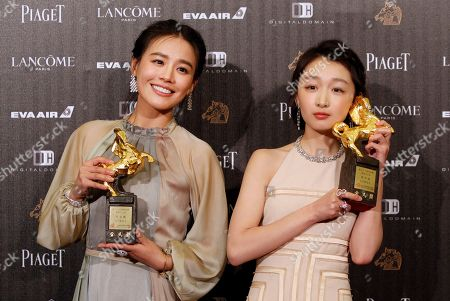 "Zhou Dongyu, right, and Ma Sichun hold their award for Best Leading Actress at the 53rd Golden Horse Awards in Taipei, Taiwan. Romance drama ""Soul Mate"" has charmed the Hong Kong Film Awards. The coming-of-age tale of two girls falling for the same boy received 12 nominations, with Zhou and Ma both getting nods in the best actress category. The awards ceremony is on April 9"