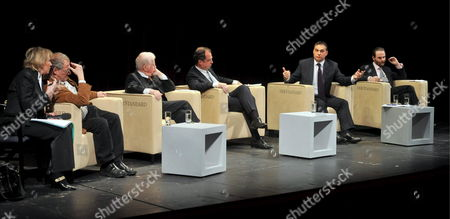 President of Conservative Party Fidesz - Hungarian Civic Alliance of Hungary Viktor Orban (r-2) Gestures at a Talk Show in Burgtheater in Vienna Austria 22 February 2009 As He Speaks About Hungary's Recent History Politicians and Historians Attended a Public Live Discussion at the Forum '20 Years After 1989' As They Gave an Account on the Times Since 20 Years Ago when a Dramatic Change Took Place in the Societies of Former Warsaw Pact States with the Collapse of the Communist Bloc Also on the Podium: (l-r) Historian Adam Michnik of Poland Kurt Biedenkopf of Former Premier of Saxony Moderator Krzysztof Michalski and Historian Timothy Garton Ash of United Kingdom Austria Vienna