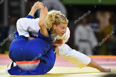 Kayla Harrison (white) of the Usa Wins Against Abigel Joo of Hungary in the Quarterfinal of Women's Judo 78kg Weight Category of the Rio 2016 Summer Olympic Games in Carioca Arena 2 in Rio De Janeiro Brazil 11 August 2016 Brazil Rio De Janeiro