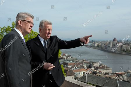 Latvian President Valdis Zatlers (l) is Shown the Panorama by His Hungarian Counterpart Pal Schmitt on the Terrace of the Presidential Alexander Palace During Their Bilateral Meeting in Budapest Hungary 08 April 2011 in the Background the River Danube and the Parliament Building (r) Are Seen Zatlers Will Participate in the Two-day Meeting of Heads of State of Arraiolos Group in the Hungarian Capital Hungary Budapest