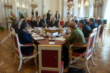 (l-r Clockwise) Presidents Danilo Turk of Slovenia Heinz Fischer of Austria Valdis Zatlers of Latvia Christian Wulff of Germany Pal Schmitt of Hungary Giorgio Napolitano of Italy Bronislaw Komorowski of Poland Anibal Cavaco Silva of Portugal and Tarja Halonen of Finland Sit at the Conference Table During Their Meeting the Presidential Alexander Palace the Second Day Meeting of Heads of State of Arraiolos Group Plus Slovenia in Budapest Hungary 09 April 2011 Hungary Budapest