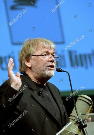 Stock Photo of Honorary Guest Norwegian Writer Jostein Gaarder Speaks on the Stage After He was Awarded with the Budapest Grand Prize During the Opening of the 23rd Budapest International Book Festival in the Millenaris Park in Budapest Hungary 21 April 2012 Hungary Budapest