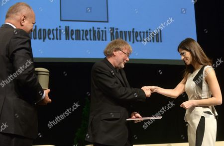 Honorary Guest Norwegian Writer Jostein Gaarder (c) Takes Over His Award the Budapest Grand Prix From Deputy Mayor of Budapest Alexandra Szalay-bobrovniczky (r) During the Opening of the 23rd Budapest International Book Festival at the Millenaris Park in Budapest Hungary 21 April 2012 Hungary Budapest