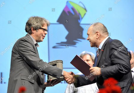 Us Writer Jonathan Franzen Receives the Budapest Grand Prix From the President of the Hungarian Publishers' and Booksellers' Association (mkke) Andras Sandor Kocsis (r) During the Opening of the 22nd Budapest International Book Festival at the Millenaris Theatre in Budapest Hungary 23 April 2015 Hungary Budapest