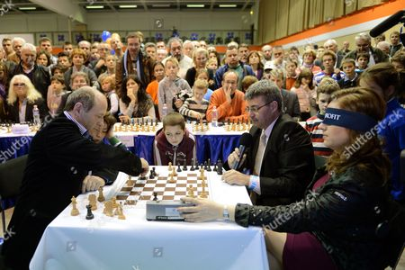 Hungarian Chess Grandmaster Judit Polgar (r) Plays Blindfolded Against Hungarian Conductor Ivan Fischer Co-founder Music Director of Budapest Festival Orchestra (l) During the Vi Aquaprofit-polgar International Chess Fest in Budapest Hungary 17 November 2012 Hungary Budapest